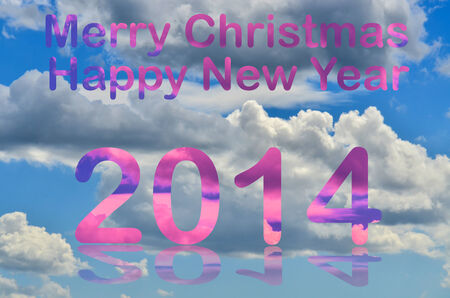 White clouds over the blue sky with merry christmas and happy new year 2014 letters photo