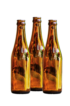 Emty brown glass bottles on white background photo