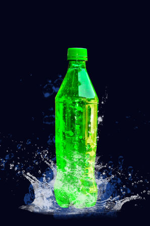 Green plastic bottle with blue water photo