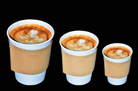Coffee takeaway cups in three size on black background photo