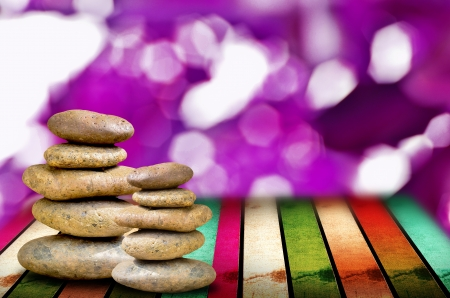 muti: zen stones on the muti color wooden and violet abstack Stock Photo