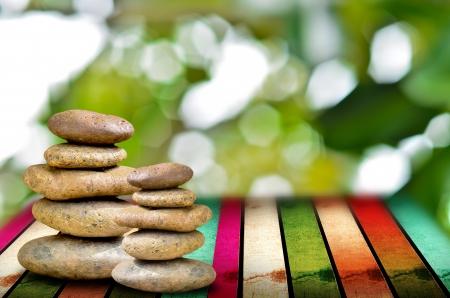 muti: zen stones on the muti color wooden