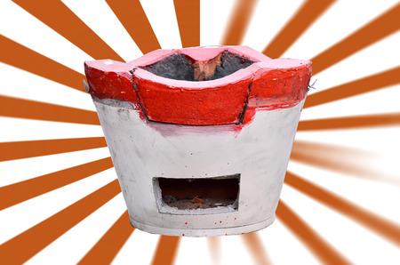 stoking: Charcoal stove of thai style on orange ray Stock Photo