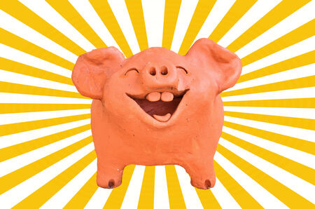 Laughing pig statue on sun beam photo
