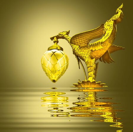 Golden swan sculpture on yellow background Stock Photo