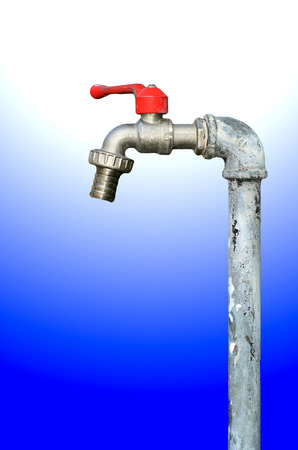 faucet with red handles on white light background