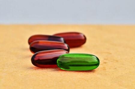 Bright green capsules in brown capsules photo