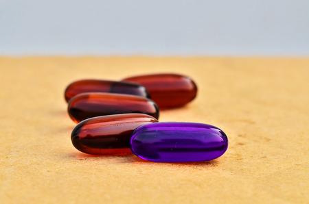 Bright violet capsules in brown capsules photo
