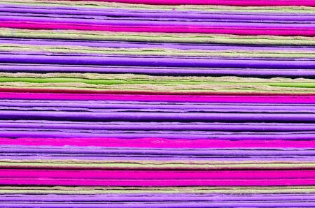 Colorful background made of stacked magazines photo