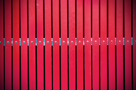 palisade: red steel palisade on white light