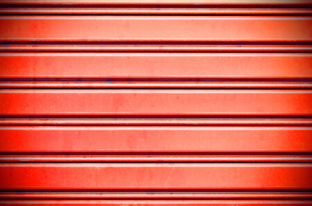 red with light metal security roller door background photo
