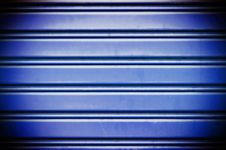 blue with light metal security roller door background photo
