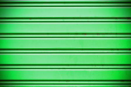 green with light metal security roller door background photo