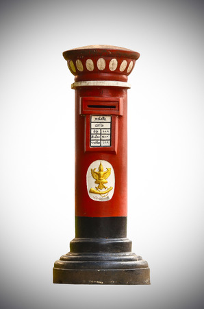 Old Red Thailand post box isolate on white light background photo