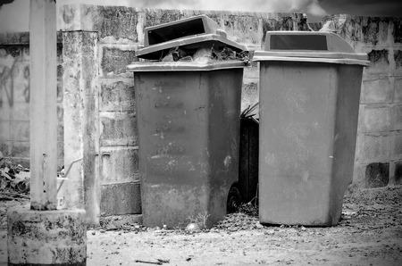 Bin full of rubbish in vintage light Stock Photo