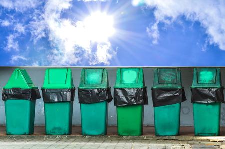 trash can on blue sky and sunshine photo