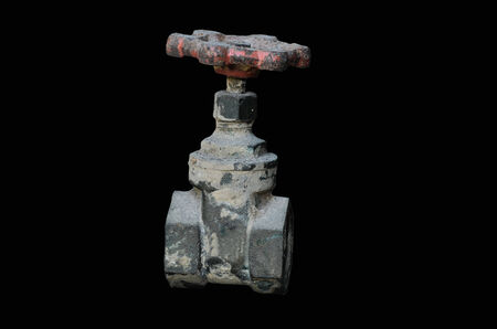 Old Water valve on black background photo