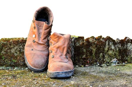 dirty feet: Dirty old shoes on white background Stock Photo