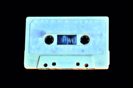 disuse: Old Cassette tape isolated on black background