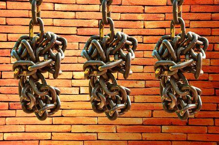 secrete: Old chain on brick wall background