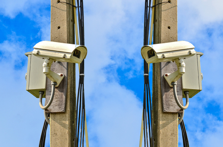 electronic survey: Two closed circuit camera on blue sky background