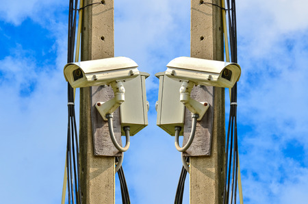 closed circuit: Two closed circuit camera on blue sky background