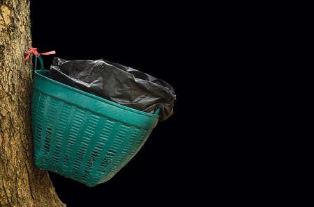 waste basket: Waste basket on tree in black background