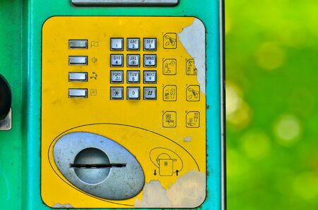 payphone: Buttons street payphone on green nature background Stock Photo