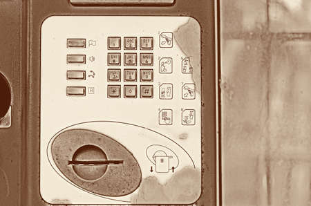 payphone: Buttons street payphone on old vintage light