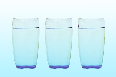 included: water glass isolated with clipping path included on two tone background