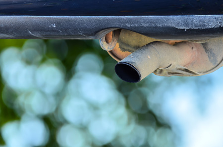 exhaust pipe: exhaust pipe car on green nature background Stock Photo