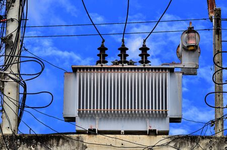 powerline: High voltage power transformer on blue sky background Stock Photo
