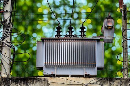 power transformer: High voltage power transformer on green nature background