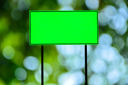 galvanised: Green traffic road sign on green nature  background