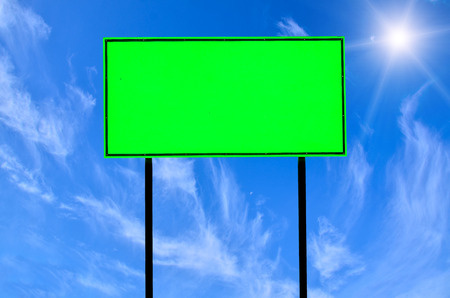 galvanised: Green traffic road sign on blue sky background