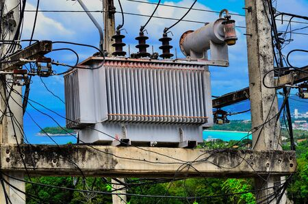 transformer: High voltage power transformer on blue sky background Stock Photo