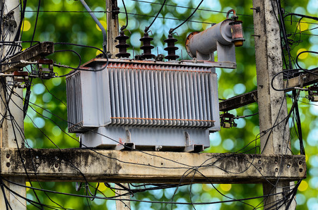 powerline: High voltage power transformer on green bokey background
