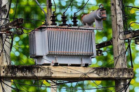 power transformer: High voltage power transformer on green bokey background
