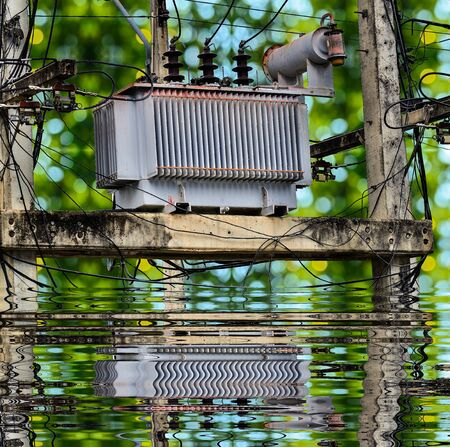 power transformer: High voltage power transformer on green bokey and reflect background