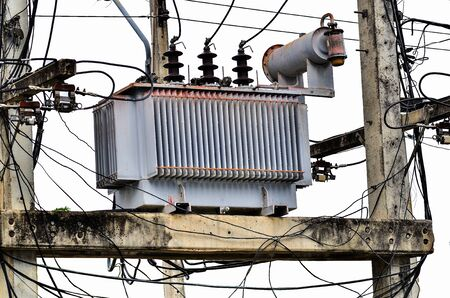 powerline: High voltage power transformer on white background