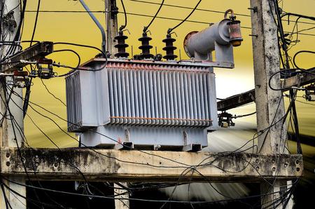 power transformer: High voltage power transformer on sun set background Stock Photo