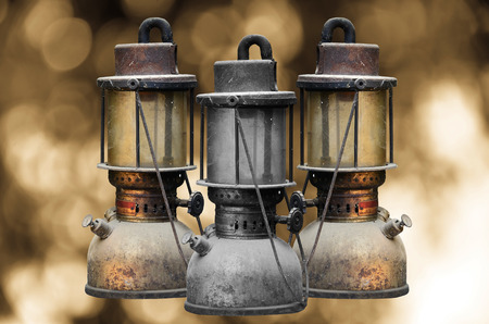 hurricane lamp: Group old hurricane lamp on sun abstract background