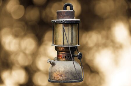 hurricane lamp: old hurricane lamp on sunny abstract background