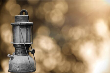 kerosene: Old hurricane lamp on sunny flare background