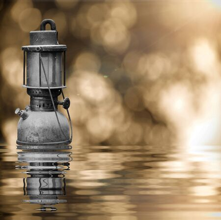 hurricane lamp: Old hurricane lamp on sunny flare and reflect