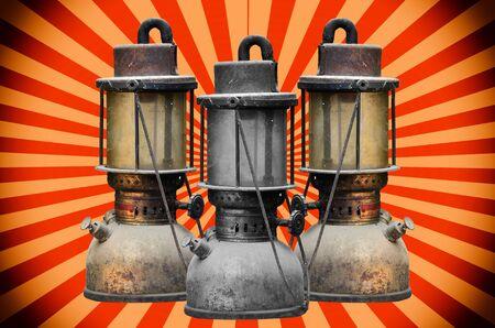 hurricane lamp: Group old hurricane lamp on sun beeam background Stock Photo