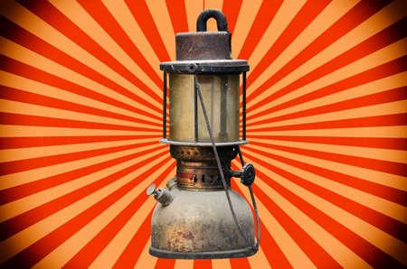 hurricane lamp: old hurricane lamp on sun beeam background