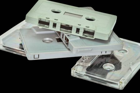 analogical: Audio cassette and tape on black background Stock Photo