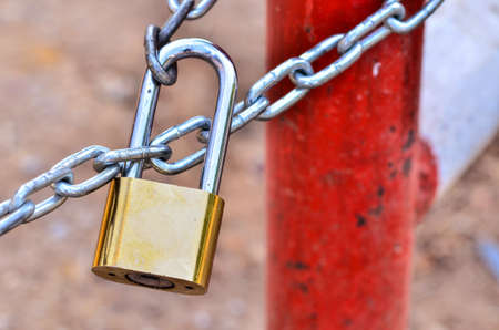lock and key: Key lock locked with a chain Stock Photo