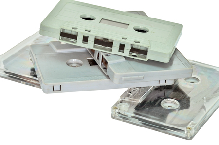 analogical: Audio cassette and tape on white background